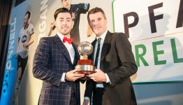 Richie Towell receives the player of the year trophy from Roy Keane