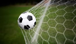 Image of football hitting net